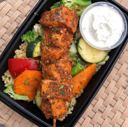 Pork Souvlaki with yellow rice, tzatziki, peppers, carrots, zucchini