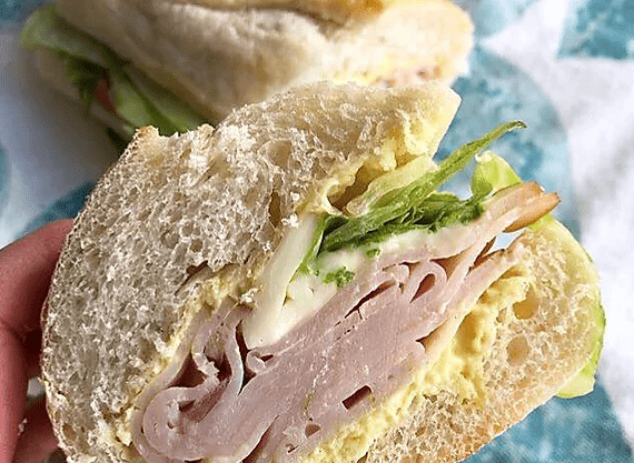 Turkey Sandwich with lettuce, red onions, and cheese